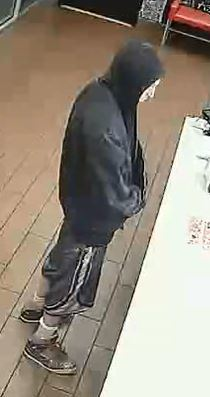 Police are seeking help finding the suspect who robbed a Domino's Pizza restaurant on May 13. (Las Vegas Metropolitan Police Department)