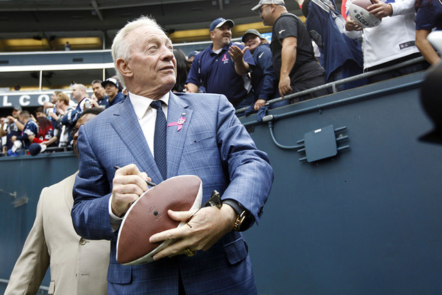 Dallas Cowboys owner Jerry Jones signs autographs during pre-game warmups against the Seattle Seahawks at CenturyLink Field in Seattle, Oct 12, 2014. (Joe Nicholson/USA Today Sports)