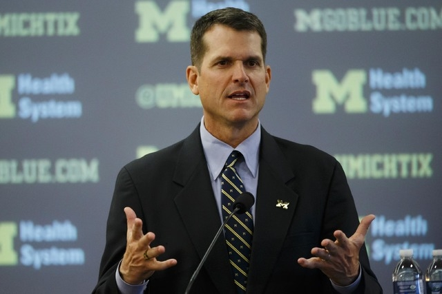 Dec 30, 2014; Ann Arbor, MI, USA; Jim Harbaugh speaks to the media as he is introduced as the new head football coach of the Michigan Wolverines at Jonge Center. (Rick Osentoski/USA Today Sports)