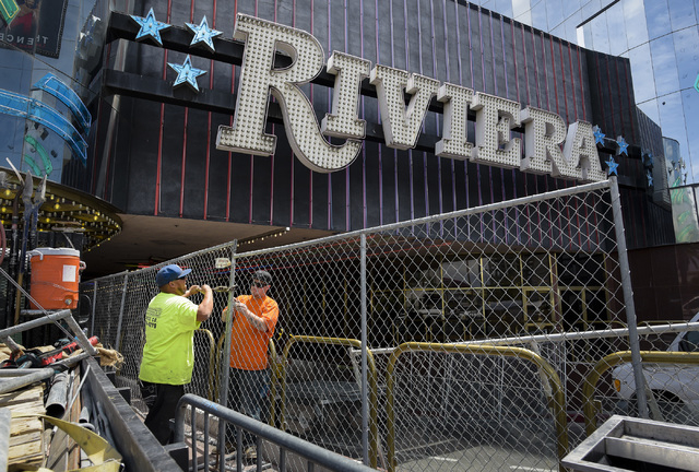 Workers from All-Star Fence assemble the perimeter surrounding the iconic Riviera Hotel & Casino in Las Vegas, which closed on Monday, May 4, 2015 after 60 years. (Mark Damon/Las Vegas News Bu ...