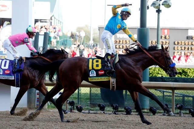 Victor Espinoza aboard American Pharoah celebrates winning the 141st Kentucky Derby at Churchill Downs in Louisville, May 2, 2015. (Peter Casey/USA Today Sports)