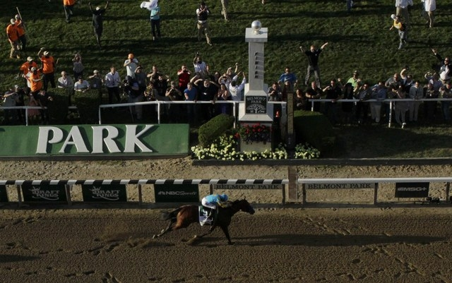 American Pharoah, with jockey Victor Espinoza, crosses the finish line to win the 147th running of the Belmont Stakes as well as the Triple Crown, in Elmont, New York June 6, 2015. (Carlo Allegri/ ...