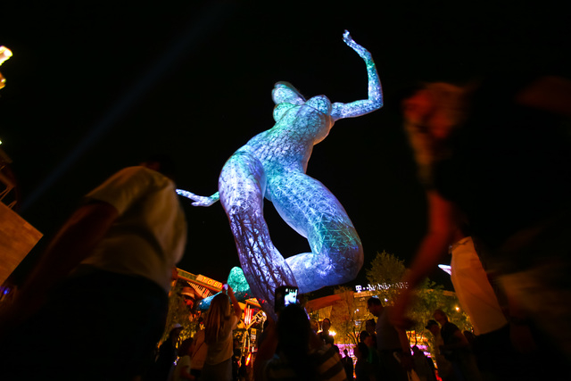 People check out the 40-foot tall Bliss Dance sculpture at The Park, outside of the T-Mobile Arena and New York New York hotel-casino in Las Vegas on Monday, April 6, 2016.  (Chase Stevens/Las Veg ...