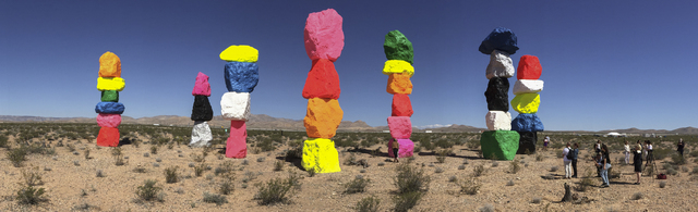Seven Magic Mountains -- a large-scale, site-specific public artwork by the artist Ugo Rondinone -- is seen in a panorama photo looking west near the Jean Dry Lake south of Las Vegas on Monday, Ma ...