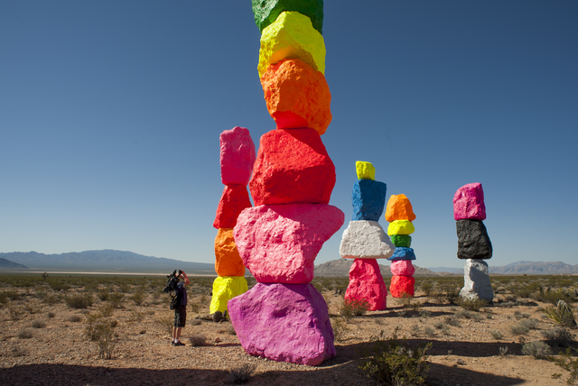 A news photographer captures Seven Magic Mountains -- a large-scale, site-specific public artwork by the artist Ugo Rondinone near the Jean Dry Lake south of Las Vegas on Monday, May 9, 2016. (Mar ...