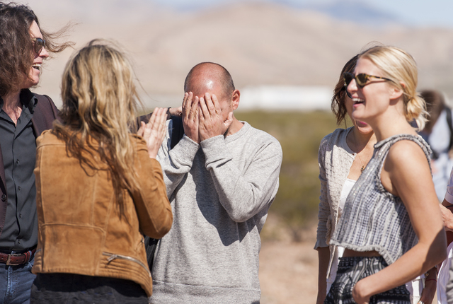 Artist Ugo Rondinone, center, is greeted as Art Production Fund and the Nevada Museum of Art celebrate the opening of Seven Magic Mountains -- Rondinone's large-scale, site-specific public artwork ...