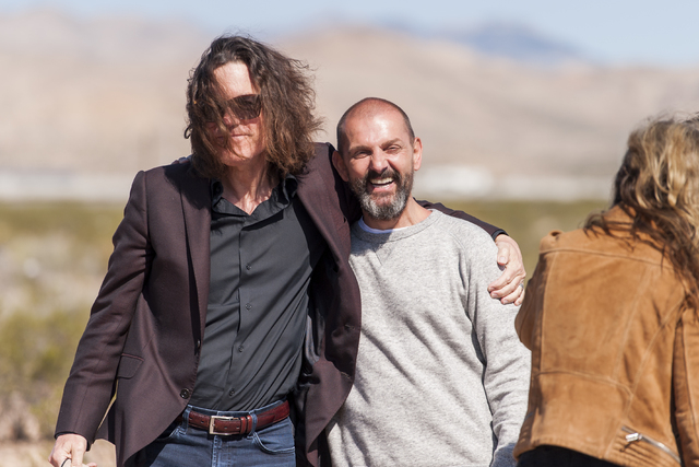Artist Ugo Rondinone, right, is greeted by David Walker, executive director of the Nevada Museum of Art, as the museum and Art Production Fund celebrate the opening of Seven Magic Mountains -- Ron ...