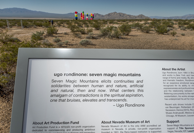 Informational plaques introduce visitors to Seven Magic Mountains -- a large-scale, site-specific public artwork by the artist Ugo Rondinone near the Jean Dry Lake south of Las Vegas on Monday, Ma ...