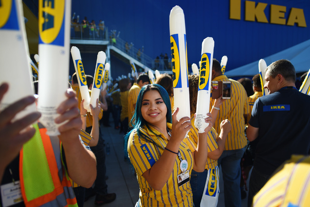 IKEA workers bang noise sticks together during the grand opening of Nevada's first IKEA home furnishings store Wednesday, May 18, 2016.  (Sam Morris/Las Vegas News Bureau)