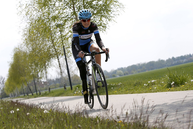 German paralympic cycling athlete Denise Schindler warms up in Olching near Munich, Germany, May 2, 2016. Schindler tests the second prototype of a prosthesis made using a new 3D printing technolo ...