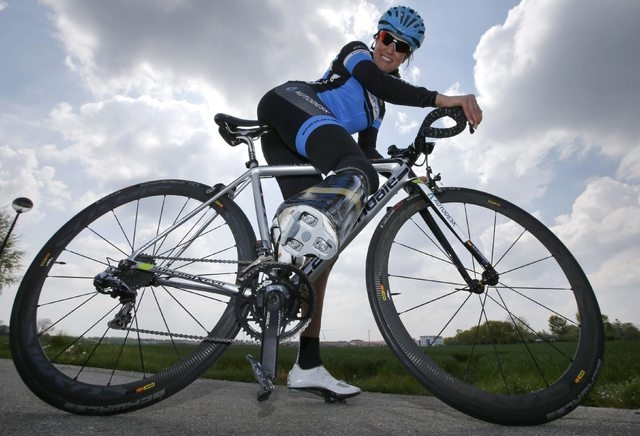 German paralympic cycling athlete Denise Schindler poses on her bicycle in Olching near Munich, Germany, May 2, 2016. Schindler tests the second prototype of a prosthesis made using a new 3D print ...