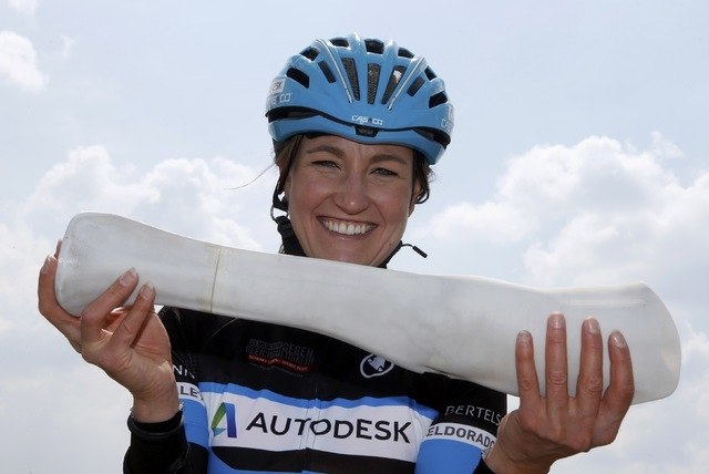 German paralympic cycling athlete Denise Schindler poses with an artifical leg (second 3D printed prototype) in Olching near Munich, Germany, May 2, 2016. Schindler tests the second prototype of a ...