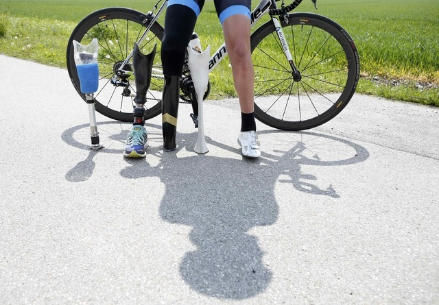 German paralympic cycling athlete Denise Schindler poses with her bicycle and her different artifical legs in Olching near Munich, Germany, May 2, 2016. Schindler tests the second prototype of a p ...