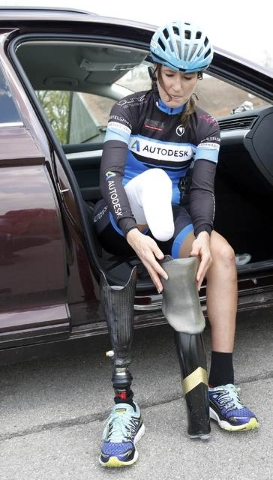 German paralympic cycling athlete Denise Schindler, changes her artificial leg to a specially developed prosthesis for cycling in Olching near Munich, Germany, May 2, 2016. Schindler tests the sec ...