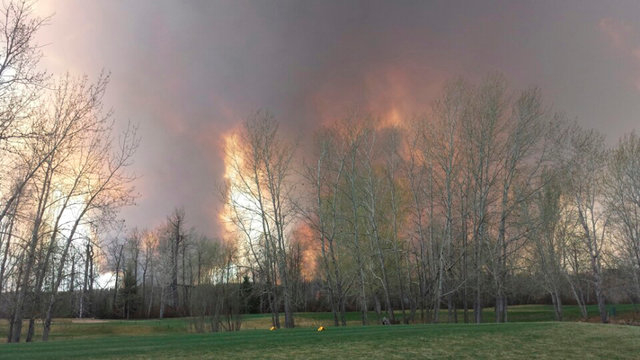 Wildfire is seen from MacDonald Island Park near Fort McMurray, Alberta May 3, 2016. An uncontrolled wildfire burning near Fort McMurray in northern Alberta, the heart of Canada's oil sands region ...