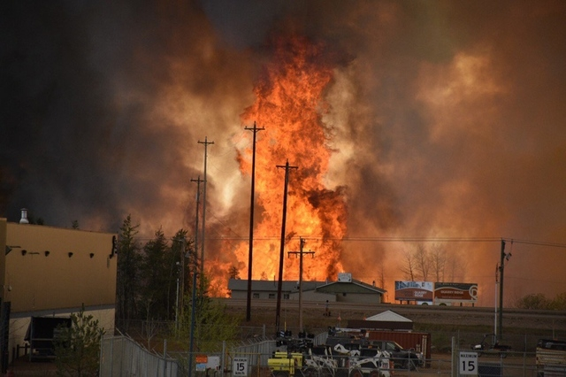 Flames rise in Industrial area south Fort McMurray, Alberta Canada May 3, 2016. (Courtesy CBC News/Handout via Reuters)