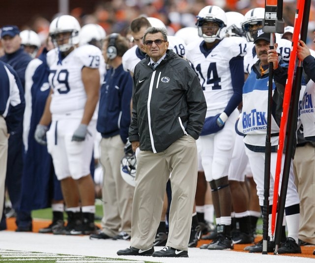 Penn State University head coach Joe Paterno looks toward the scoreboard during his team's game against the University of Illinois in their NCAA football game in Champaign, Illinois, U.S. October  ...