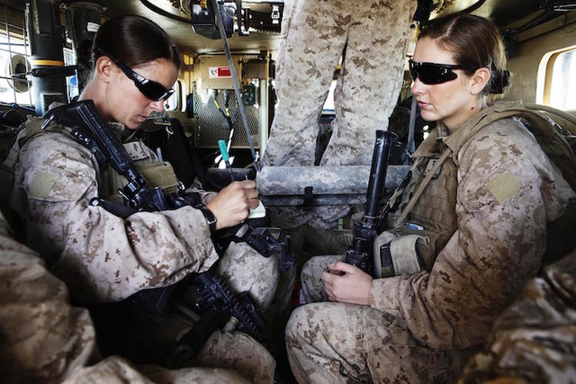 U.S. Marine and Female Engagement Team leader Sgt. Sheena Adams (L) and H.N. Shannon Crowley from First Battalion, Eighth Marines sit in an armoured vehicle before heading out on an operation from ...