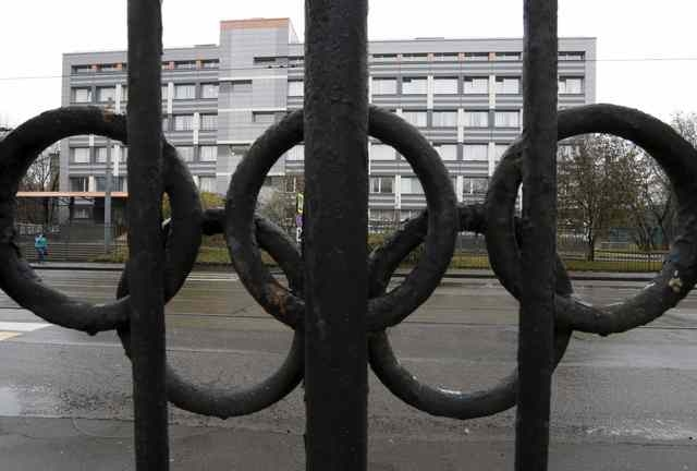 """A view through a fence, decorated with the Olympic rings, shows a building of the federal state budgetary institution """"Federal scientific centre of physical culture and sports,"""" which houses a lab ..."""