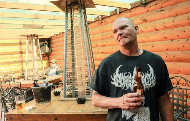 Mark Ohl hangs out at Cattails, a dive bar in Williston, North Dakota, U.S. May 15, 2016. Ohl lost his job on an oil rig when the company lost a major contract; he has since found a new job in the ...