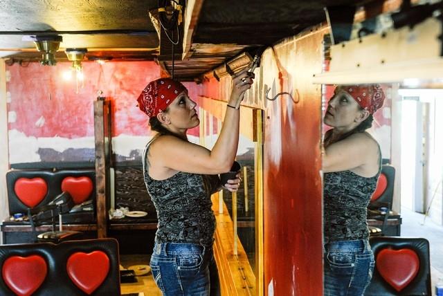 Kris Wishinsky, a contractor hired to renovate Heartbreakers, paints inside the bar in Williston, North Dakota, U.S. May 15, 2016. (Andrew Cullen/Reuters)