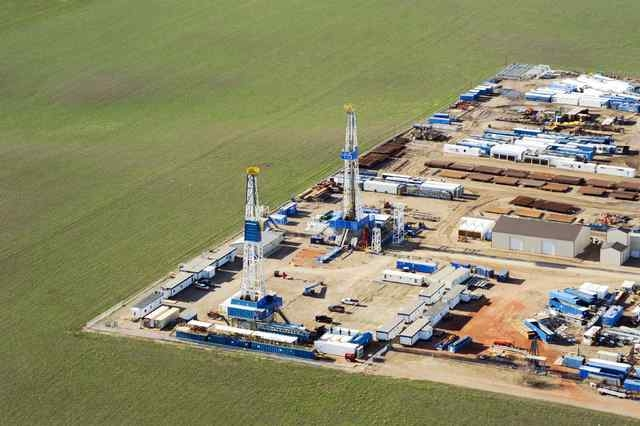 Stacked rigs and other idle oil equipment is seen in a Nabors Drilling yard near Williston, North Dakota April 30, 2016. (Andrew Cullen/Reuters)