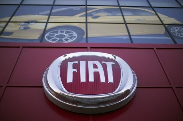 The Fiat logo is pictured at a car dealership at Motor Village in Los Angeles, California October 13, 2014. (Mario Anzuoni/Reuters)