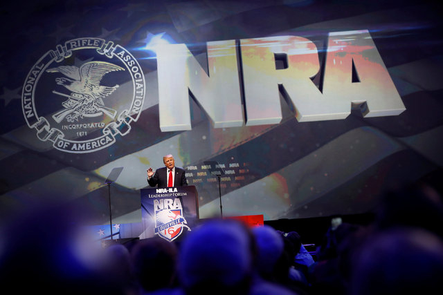 U.S. Republican presidential candidate Donald Trump attends the National Rifle Association's NRA-ILA Leadership Forum during their annual meeting in Louisville, Kentucky, U.S., May 20, 2016. (Aaro ...