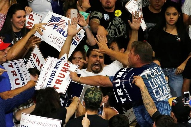 A protester disrupts a rally with Republican U.S. presidential candidate Donald Trump and his supporters in Albuquerque, New Mexico, U.S. May 24, 2016. (Jonathan Ernst/Reuters)