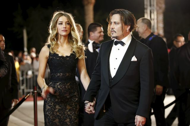 Desert Palm Achievement Award recipient actor Johnny Depp and wife actress Amber Heard pose at the 27th Annual Palm Springs International Film Festival Awards Gala in Palm Springs, California, Jan ...