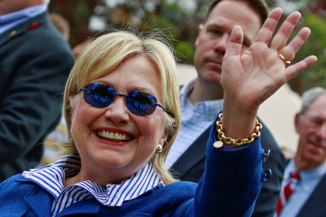 Democratic presidential candidate Hillary Clinton waves as she takes part in the Memorial Day parade in Chappaqua, New York, May 30, 2016. (Adrees Latif/Reuters)