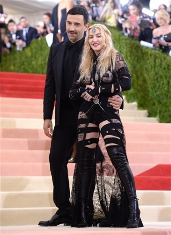 "Riccardo Tisci, left, and Madonna arrive at The Metropolitan Museum of Art Costume Institute Benefit Gala, celebrating the opening of ""Manus x Machina: Fashion in an Age of Technology"" on Monday,  ..."