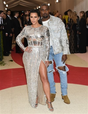 "Kim Kardashian, left, and Kanye West arrive at The Metropolitan Museum of Art Costume Institute Benefit Gala, celebrating the opening of ""Manus x Machina: Fashion in an Age of Technology& ..."
