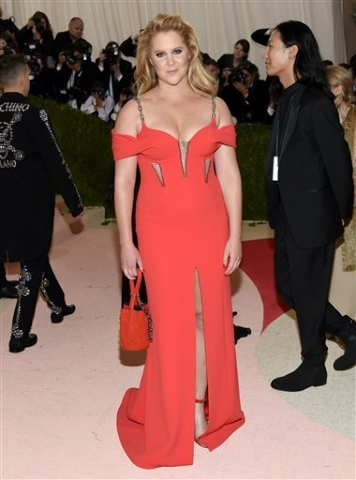 "Amy Schumer arrives at The Metropolitan Museum of Art Costume Institute Benefit Gala, celebrating the opening of ""Manus x Machina: Fashion in an Age of Technology"" on Monday, May 2, 2016, in New Y ..."