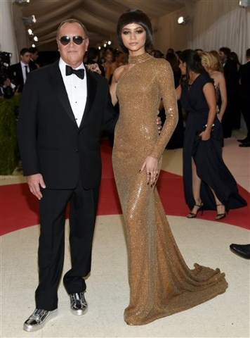"Michael Kors, left, and Zendaya arrive at The Metropolitan Museum of Art Costume Institute Benefit Gala, celebrating the opening of ""Manus x Machina: Fashion in an Age of Technology"" on Monday, Ma ..."