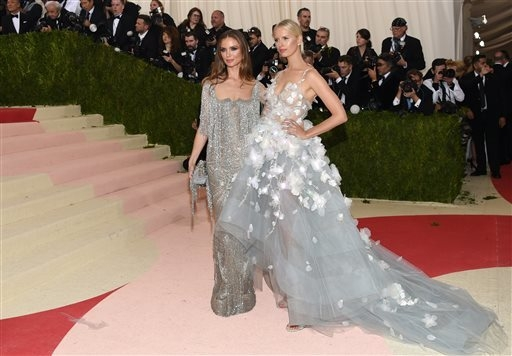 "Georgina Chapman, left, and Karolina Kurkova arrive at The Metropolitan Museum of Art Costume Institute Benefit Gala, celebrating the opening of ""Manus x Machina: Fashion in an Age of Tec ..."
