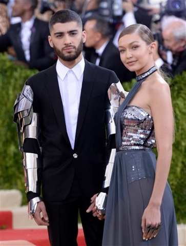 "Zayn Malik, left, and Gigi Hadid arrive at The Metropolitan Museum of Art Costume Institute Benefit Gala, celebrating the opening of ""Manus x Machina: Fashion in an Age of Technology"" on Monday, M ..."
