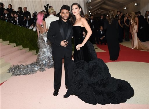 "The Weeknd, left, and Bella Hadid arrive at The Metropolitan Museum of Art Costume Institute Benefit Gala, celebrating the opening of ""Manus x Machina: Fashion in an Age of Technology"" on Monday,  ..."