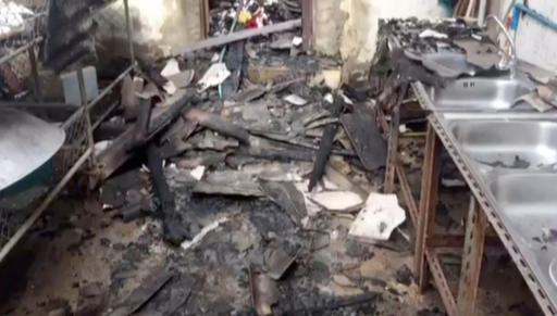 In this image made from video, the inside of a damaged school dormatory is seen where local police say 18 girls, ranging from 5 to 12 years old, died in a fire in Chiang Rai province, northern Tha ...