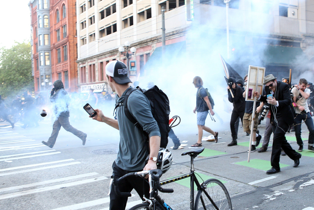 A blast ball explodes on 3rd Avenue and Washington in Pioneer Square on Sunday, May 1, 2016, in Seattle, Wash. (Lindsey Wasson/The Seattle Times via Associated Press)