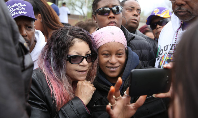 Princes sister, Tyka Nelson, left, greeted fans during a Prince Block Party Saturday, April 30, 2016, at Sabathani Community Center in Minneapolis, Minn. (Jim Gehrz/Star Tribune via AP)