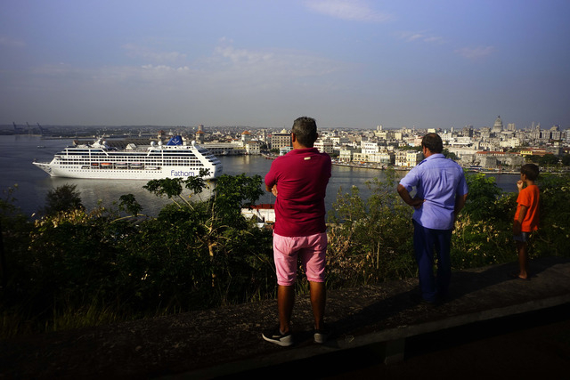 People watch the Carnival Adonia cruise ship arrive from Miami, in Havana, Cuba, Monday, May 2, 2016. The Adonia's arrival is the first step toward a future in which thousands of ships a year coul ...