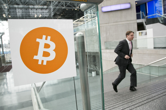 A man arrives for the Inside Bitcoins conference and trade show in New York, April 7, 2014. An Australian man long thought to be associated with the digital currency Bitcoin has publicly identifie ...