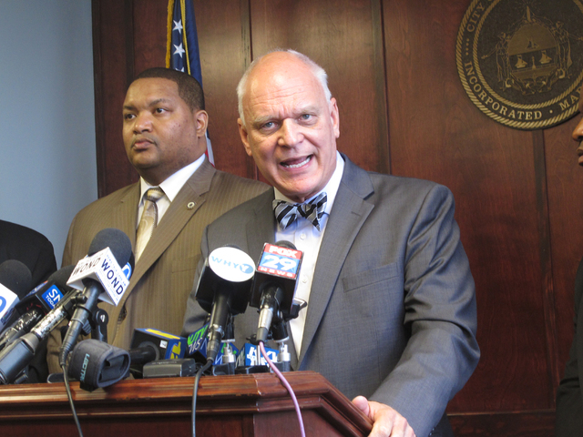 Atlantic City Councilman Marty Small, left, and Mayor Don Guardian, right, speak at a news conference in Atlantic City, N.J., Monday, May 2, 2016, at which the mayor announced the city had made a  ...