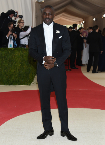 "Idris Elba arrives at The Metropolitan Museum of Art Costume Institute Benefit Gala, celebrating the opening of ""Manus x Machina: Fashion in an Age of Technology"" on Monday, May 2, 2016, in New Yo ..."