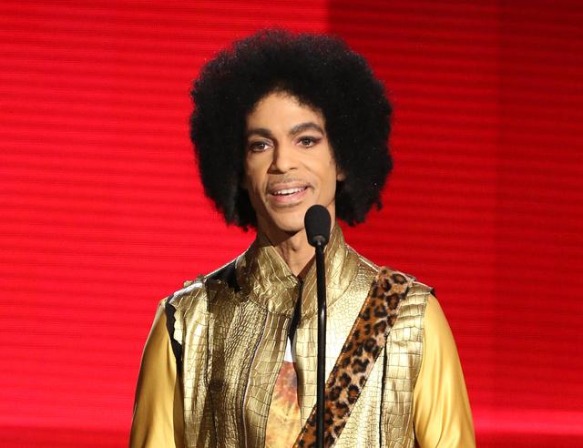 Prince presents an award at the American Music Awards in Los Angeles, Nov. 22, 2015. (Matt Sayles/Invision/AP)