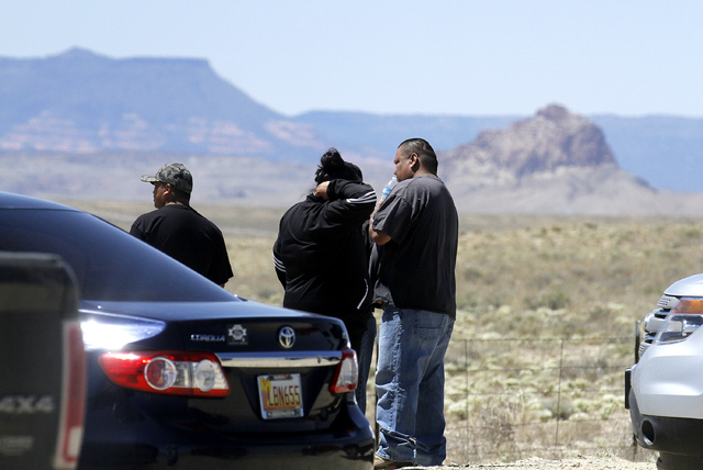 Family and friends gather along Navajo Route 13, just a few miles from where Ashlynne Mike's body was discovered south of Shiprock, N.M., on Tuesday, May 3, 2016. (Jon Austria/The Daily Times via AP)