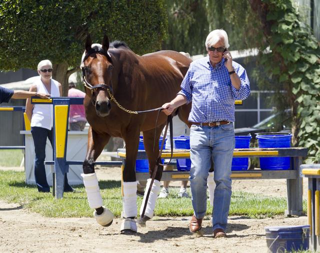FILE - In this June 18, 2015, file photo, trainer Bob Baffert walks Triple Crown winner American Pharoah after the horse arrived at Santa Anita Park in Arcadia, Calif. Baffert is back at Churchill ...