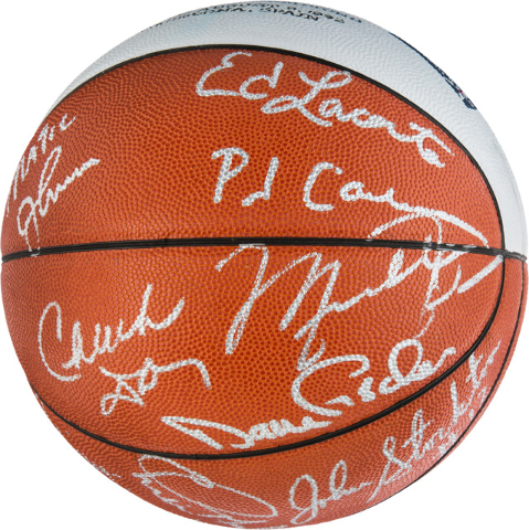"""This April 27, 2016 photo courtesy of Heritage Auctions shows a 1992 Barcelona Olympics """"Dream Team"""" signed presentation basketball given to Dr. David A. Fischer, the team physician. (David Fewell ..."""