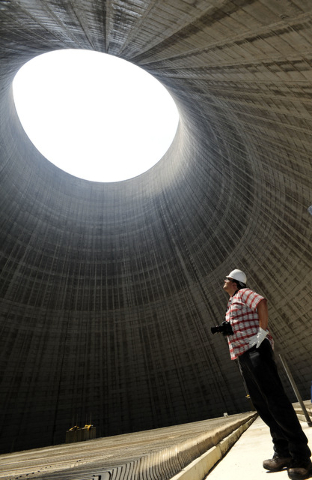 FILE - In this June 2, 2011 file photo, Tennessee Valley Authority worker Damien Powe stands inside one of the two the 500-foot cooling towers at the Bellefonte Nuclear Plant site in Hollywood, Al ...